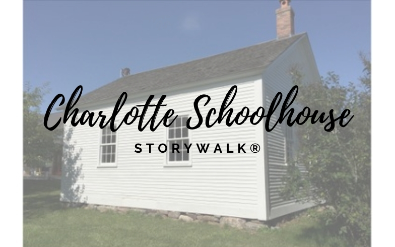 Image: White one room schoolhouse with bright blue sky. Text: Charlotte Schoolhouse Storywalk